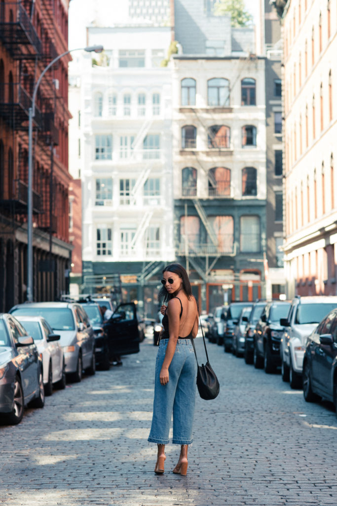 a backless bodysuit & chunky heel mules